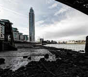 under Vauxhall Bridge, tide out London